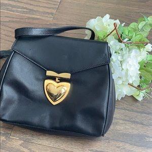 Vintage black escada satchel with heart clasp